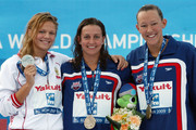 Yuliya Efimova of Russia (L) celebrates the silver medal, Rebecca Soni of United States (C) the gold medal and Kasey Carlson of United States the bronze medal during the medal ceremony for the Women's 100m Breaststroke Final during the 13th FINA World Championships at the Stadio del Nuoto on July 28, 2009 in Rome, Italy.