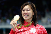 Gold medalist Rie Kaneto of Japan celebrates on the podium during the medal ceremony for the Women's 200m Breaststroke Final  on Day 6 of the Rio 2016 Olympic Games at the Olympic Aquatics Stadium on August 11, 2016 in Rio de Janeiro, Brazil.