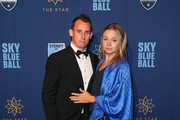 Luke Wilkshire and Kristina Wilkshire pose at the Sydney FC Sky Blue Ball on May 19, 2018 in Sydney, Australia.