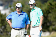Brandt Snedeker and Toby Wilt wait on the fifth green during the final round of the AT&T Pebble Beach National Pro-Am at the Pebble Beach Golf Links on February 15, 2015 in Pebble Beach, California.