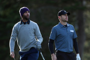 James Blake watches his tee shot, as Andy Roddick looks on during a practice round for the AT&T Pebble Beach National Pro-Am at Monterey Peninsula Country Club on February 5, 2014 in Pebble Beach, California.