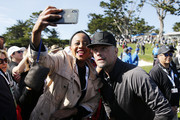 Actor Josh Duhamel takes a selfie with a fan during the 3M Celebrity Challenge prior to the AT&T Pebble Beach Pro-Am at Pebble Beach Golf Links on February 05, 2020 in Pebble Beach, California.