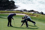 Phil Mickelson of the United States, Patrick Reed of the United States and Scott Ozanus, Deputy Chairman and Chief Operating Officer of KPMG, prepare to putt on the seventh green during the third round of the AT&T Pebble Beach Pro-Am at Pebble Beach Golf Links on February 09, 2019 in Pebble Beach, California.