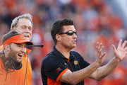 Head Coach Mike Gundy of the Oklahoma State Cowboys gestures about an official's call during the game against the TCU Horned Frogs November 7, 2015 at Boone Pickens Stadium in Stillwater, Oklahoma. The Cowboys defeated the Horned Frogs 49-29.