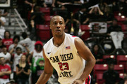 D.J. Gay #23 of San Diego State looks to pass the ball against TCU at Cox Arena on February 5, 2011 in San Diego. SDSU beat TCU 60-53.