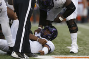 Shawn Robinson #3 of the TCU Horned Frogs holds his shoulder after a hit in the fourth quarter against the Texas Longhorns at Darrell K Royal-Texas Memorial Stadium on September 22, 2018 in Austin, Texas.