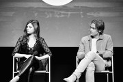 """Image has been shot in black and white. Color version is not available.) India Eisley (L) and Chris Pine speak onstage at TNT's """"I Am The Night"""" FYC Event on May 9, 2019 in North Hollywood, California."""