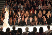 (2nd L-R) Actress Joy Bryant, Angela Simmons, Kelly Osbourne, designer Nicky Hilton, Whitney Port, actress Holland Roden, model Jessica Hart, actresses Nasim Pedrad and Abby Elliott attend the Charlotte Ronson Spring 2012 fashion show during Mercedes-Benz Fashion Week at The Stage at Lincoln Center on September 10, 2011 in New York City.