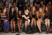 (2nd L-R) Actress Joy Bryant, Angela Simmons, Kelly Osbourne, designer Nicky Hilton, Whitney Port and actress Holland Roden attend the Charlotte Ronson Spring 2012 fashion show during Mercedes-Benz Fashion Week at The Stage at Lincoln Center on September 10, 2011 in New York City.