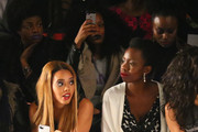 (L-R) Actors Angela Simmons and Adepero Oduye attend the Vivienne Tam fashion show with TRESemme during Mercedes-Benz Fashion Week Fall 2014 at The Theater at Lincoln Center on February 9, 2014 in New York City.