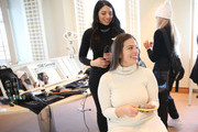 TRESemme Global Stylist Justine Marjan prepares Model Ashley Graham backstage for TRESemme at Christian Siriano for NYFW on February 9, 2019 in New York City.