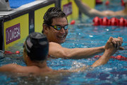Nathan Adrian, right, shakes the hand of Matt Grevers after winning the men's 100 meter freestyle prliminary race during the TYR Pro Swim Series at Indiana University Natatorium on May 17, 2018 in Indianapolis, Indiana.