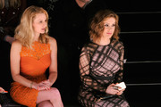 Actresses Andrea Powell and Alyssa Milano attend Tadashi Shoji fashion show during Mercedes-Benz Fashion Week Fall 2014 at The Salon at Lincoln Center on February 6, 2014 in New York City.