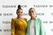 (L-R) Angela Simmons and designer Tadashi Shoji are seen backstage for Tadashi Shoji Spring/Summer 2020 during New York Fashion Week: The Shows at Gallery I at Spring Studios on September 05, 2019 in New York City.