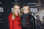 Regina Halmich (L) and Tina Ruland attend the premiere of the film '96 Hours - Taken 3' at Zoo Palast on December 16, 2014 in Berlin, Germany.