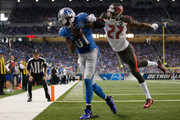 Calvin Johnson #81 of the Detroit Lions catches a first quarter touchdown in front of Johnthan Banks #27 of the Tampa Bay Buccaneers at Ford Field on December 07, 2014 in Detroit, Michigan.