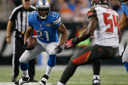 Reggie Bush #21 of the Detroit Lions looks to gain yards in the first quarter while playing the Tampa Bay Buccaneers at Ford Field on December 07, 2014 in Detroit, Michigan.