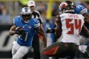 Reggie Bush #21 of the Detroit Lions looks to gain yard in the first quarter while playing the Tampa Bay Buccaneers at Ford Field on December 07, 2014 in Detroit, Michigan.