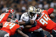 C.J. Spiller #28 of the New Orleans Saints is brought down by George Johnson #94 and Lavonte David #54 of the Tampa Bay Buccaneers during the first quarter of a game at the Mercedes-Benz Superdome on September 20, 2015 in New Orleans, Louisiana.