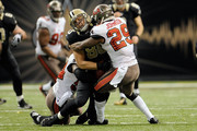 Leonard Johnson #29 of the Tampa Bay Buccaneers hits Jimmy Graham #80 of the New Orleans Saints during a game at the Mercedes-Benz Superdome on December 29, 2013 in New Orleans, Louisiana.