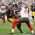 Antonio Brown #84 of the Pittsburgh Steelers gets tackled by Alterraun Verner #21 of the Tampa Bay Buccaneers during the first quarter at Heinz Field on September 28, 2014 in Pittsburgh, Pennsylvania.