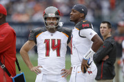 Quarterbacks Ryan Fitzpatrick #14 and Jameis Winston #3 of the Tampa Bay Buccaneers stand on the sidelines in the second quarter against the Chicago Bears at Soldier Field on September 30, 2018 in Chicago, Illinois.