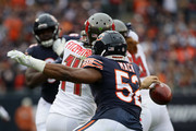 Khalil Mack #52 of the Chicago Bears strips the football away from quarterback Ryan Fitzpatrick #14 of the Tampa Bay Buccaneers in the second quarter at Soldier Field on September 30, 2018 in Chicago, Illinois.