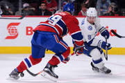 Tyler Johnson #9 of the Tampa Bay Lightning attempts to move the puck past Andrei Markov #79 of the Montreal Canadiens during the NHL game at the Bell Centre on March 10, 2015 in Montreal, Quebec, Canada.  The Lightning defeated the Canadiens 1-0 in overtime.