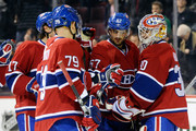 Members of the Montreal Canadiens celebrate after defeating the Tampa Bay Lightning in their NHL game at the Bell Centre on April 4, 2012 in Montreal, Quebec, Canada.  The Canadiens defeated the Lightning 5-2.