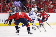 Ryan Callahan #24 of the Tampa Bay Lightning controls the puck against Michal Kempny #6 and Evgeny Kuznetsov #92 of the Washington Capitals in the first period of Game Six of the Eastern Conference Finals during the 2018 NHL Stanley Cup Playoffs at Capital One Arena on May 21, 2018 in Washington, DC.