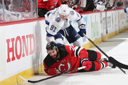 Steven Stamkos #91 of the Tampa Bay Lightning checks Kyle Palmieri #21 of the New Jersey Devils during the third period in Game Four of the Eastern Conference First Round during the 2018 NHL Stanley Cup Playoffs at the Prudential Center on April 18, 2018 in Newark, New Jersey. The Lightning defeated the Devils 3-1.