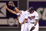 (L-R) Eddie Rosario #20, Aaron Hicks #32 and Torii Hunter #48 of the Minnesota Twins celebrate a win of the game against the Tampa Bay Rays on May 15, 2015 at Target Field in Minneapolis, Minnesota. The Twins defeated the Rays 3-2.
