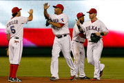 (L-R) Ian Kinsler # 5 of the Texas Rangers celebrates with Nelson Cruz #17, Elvis Andrus #1, and Josh Hamilton #32 after the Rangers beat the Tampa Bay Rays 8-1 in Game Two of the American League Division Series at Rangers Ballpark in Arlington on October 1, 2011 in Arlington, Texas.