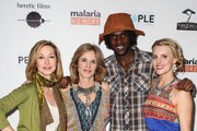 """(L-R) Actress Sharon Lawrence, producer Sylvia Caminer, Venance Ndibalema and Kristen Kenney arrive at the premiere of """"Tanzania: A Journey Within"""" benefiting Malaria No More on May 2, 2014 in North Hollywood, California."""