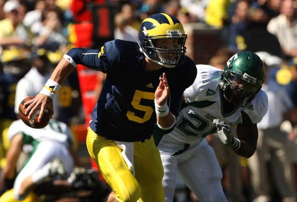 Eastern Michigan v Michigan [sports gear,sports,helmet,gridiron football,american football,player,canadian football,tournament,personal protective equipment,team sport,andre hatchett,quarterback,tate forcier 5,michigan,ann arbor,michigan stadium,eastern michigan,michigan wolverines,eastern michigan eagles]