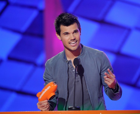Taylor Lautner Actor Taylor Lautner accepts the Favorite Butt Kicker award onstage at Nickelodeon's 25th Annual Kids' Choice Awards held at Galen Center on March 31, 2012 in Los Angeles, California.