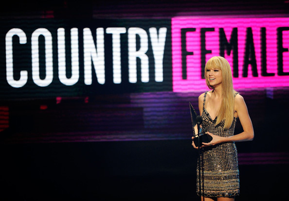 Taylor Swift Singer Taylor Swift accepts the Country Music - Favorite Female Artist award onstage during the 2010 American Music Awards held at Nokia Theatre L.A. Live on November 21, 2010 in Los Angeles, California.