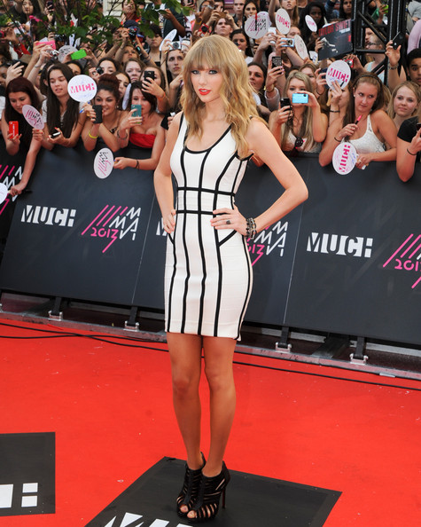 Taylor Swift Taylor Swift arrives on the red carpet at the 2013 MuchMusic Video Awards at Bell Media Headquarters on June 16, 2013 in Toronto, Canada.