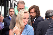 Andrea Pirlo (R) and Valentina Baldini arrive at Malpensa Airport on June 26, 2014 in Milan, Italy.