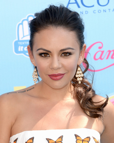 Actress Janel Parrish attends the Teen Choice Awards 2013 at Gibson Amphitheatre on August 11, 2013 in Universal City, California.