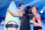 """Actress-singer Selena Gomez accepts Choice Break-up Song award for """"Come and Get It"""" from actors Chloe Grace Moretz and Christopher Mintz-Plasse onstage during the Teen Choice Awards 2013 at Gibson Amphitheatre on August 11, 2013 in Universal City, California."""