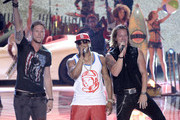 Rapper Nelly (C) and singers Tyler Hubbard and Brian Kelley of Florida Georgia Line perform performs onstage during the Teen Choice Awards 2013 at Gibson Amphitheatre on August 11, 2013 in Universal City, California.