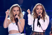 Singers Perrie Edwards (L) and  Jade Thirlwall  of Little Mix perform onstage during the Teen Choice Awards 2015 at the USC Galen Center on August 16, 2015 in Los Angeles, California.