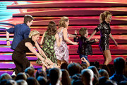 (L-R) Actors Michael Campion, Jodie Sweetin, Soni Nicole Bringas, Andrea Barber, Elias Harger and Candace Cameron-Bure accept the Choice TV Comedy award for 'Fuller House' onstage during Teen Choice Awards 2016 at The Forum on July 31, 2016 in Inglewood, California.