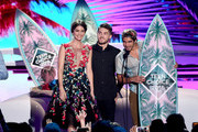 (L-R) Actors Shelley Hennig, Cody Christian and Tyler Posey accept the award for Choice Summer TV Show onstage during Teen Choice Awards 2016 at The Forum on July 31, 2016 in Inglewood, California.