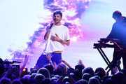 Louis Tomlinson performs onstage during the Teen Choice Awards 2017  at Galen Center on August 13, 2017 in Los Angeles, California.