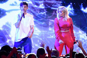 Louis Tomlinson (L) and Bebe Rexha perform onstage during the Teen Choice Awards 2017  at Galen Center on August 13, 2017 in Los Angeles, California.