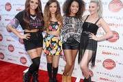 (L-R) Jesy Nelson, Jade Thirlwall, Leigh-Anne Pinnock, and Perrie Edwards of Little Mix pose at Teen Vogue's Back-to-School Saturday kick-off event at The Grove on August 9, 2013 in Los Angeles, California.