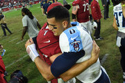 Blaine Gabbert #7 of the Arizona Cardinals and Marcus Mariota #8 of the Tennessee Titans hug after the NFL game at University of Phoenix Stadium on December 10, 2017 in Glendale, Arizona. The Arizona Cardinals won 12 - 7.
