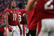 Wide receiver Larry Fitzgerald #11 of the Arizona Cardinals walks on the sidelines during the second half of the NFL game against the Tennessee Titans at the University of Phoenix Stadium on December 10, 2017 in Glendale, Arizona. The Cardinals defeated the Titans 12-7.